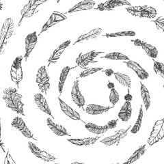 Decorative doodle feathers in a spiral. Hand drawn vintage vector design set.