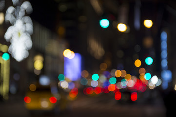 Defocus night view of holiday lights and city traffic on the streets of New York City