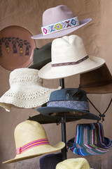 Group of colored tourist hats for sale at the market in Cusco, P