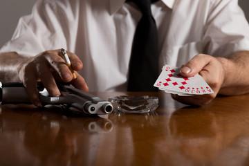 poker cards and handgun