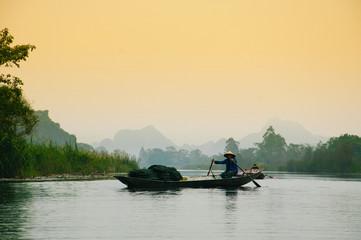 tourist boat on Yen stream in Huong pagoda, Hanoi, Vietnam.