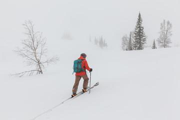 Man ski-touring at the mountains