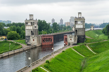View on canal with open shipping lock against skyline. Moscow, Russia.
