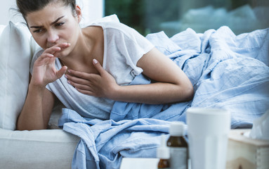 Woman with cough Wall mural