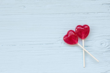 Lolly pop hearts  on a wooden background