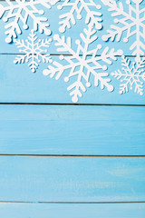 Decorative snowflakes on wooden background