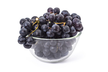 Fresh ripe red grapes clusters in a bowl on white background