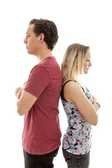Young couple standing back to back isoalted on white bakground