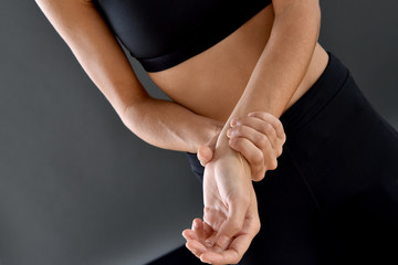 Athletic girl and painful wrist, isolated