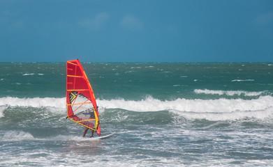 Jericoacoara, Ceara, Brazil - December 10, 2015 : Unidentified windsurfer riding on the waves in Atlantic ocean, documentary editorial.
