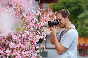 Tourist and plum blossom