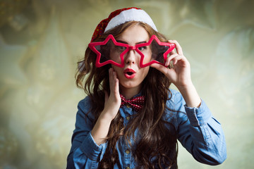 Exciting funny hipster beautiful young lady in santa hat