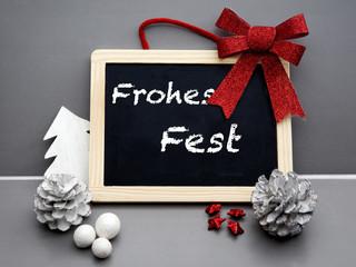 german 'Frohes Fest' (Merry Christmas) on blackboard