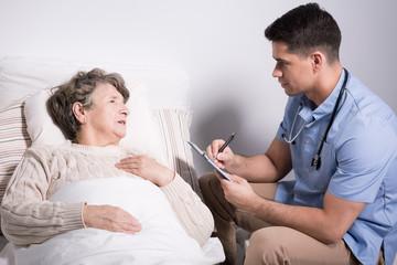 Doctor examining alzheimer patient