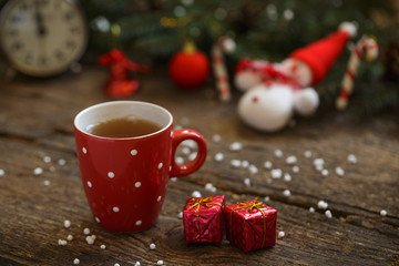 Tea cup with christmas decoration on wooden table