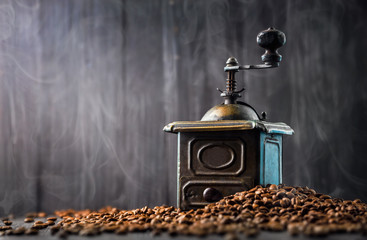Antique vintage retro bronze coffee mill on black wooden board