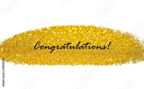 word congratulation on blurry background of golden glitter sparkles