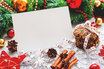 Christmas and New Year background with decorations, cookies, pine cones and clear paper for your text. Mock up.
