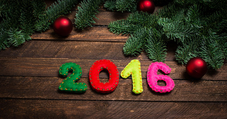 2016 made of felt and Christmas tree. Childish New year background