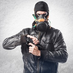 Robber holding a pistol