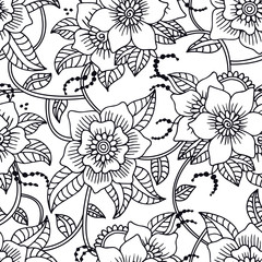 Floral seamless pattern with hand drawn doodle flowers.