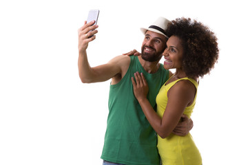 Brazilian couple taking selfie on white background