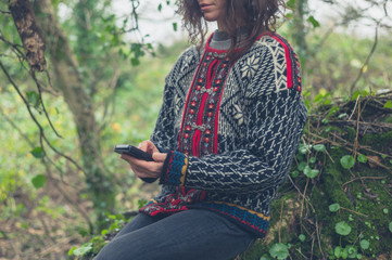 Woman using smartphone in nature