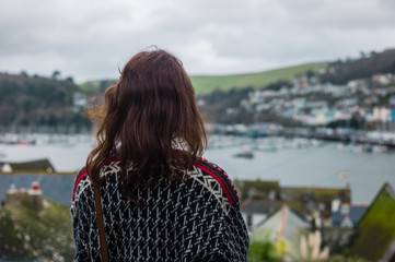 Young womamn looking at estuary
