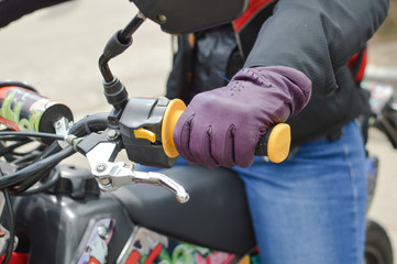Close up picture of hand on motorbike handlebar