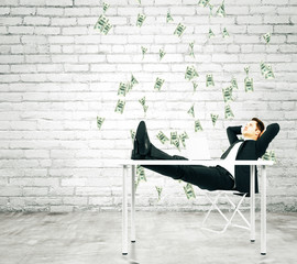Deurstickers Ontspanning Money falling from the sky on businessman resting on a chair in