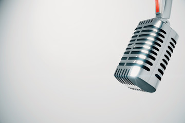 Vintage microphone at white background