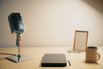 Radio microphone with diary, cup of coffe and blank picture fram
