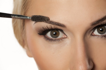 closeup of eyebrow shaping with brush
