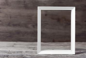 White wooden frame on grunge wood background