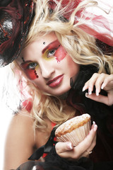 woman with creative make-up in doll style with cake.
