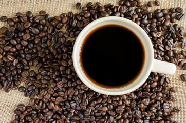 Hot americano and coffee beans