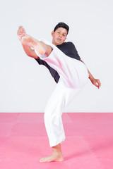 Young teenager dancing capoeira