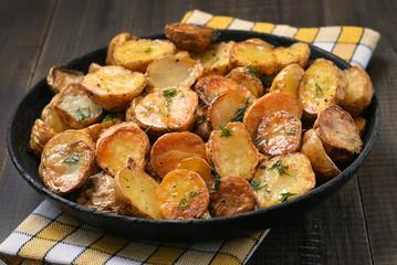 Fried potato in pan