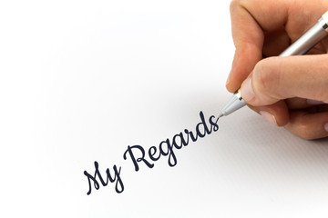 "Hand writing ""My Regards"" on white sheet of paper."