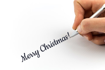 "Hand writing ""Merry Christmas!""  on white sheet of paper."