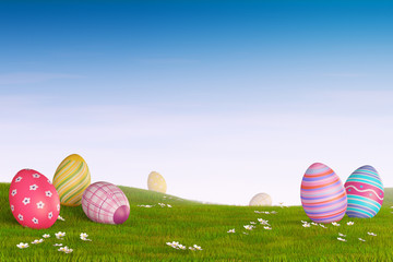Decorated Easter eggs in a grassy hilly landscape