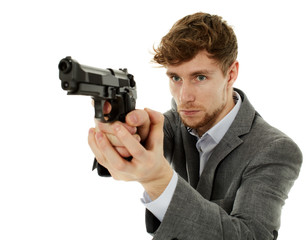 Closeup of a young man with a gun