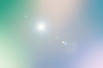 Colorful psychedelic background texture with a lens flare added