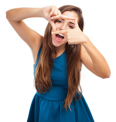 portrait of young woman doing a frame gesture on white backgroun