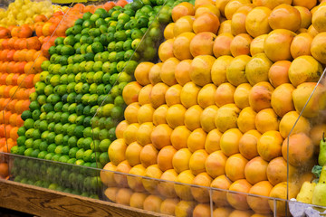 Produce market of fresh limes, grapefruit and oranges on display