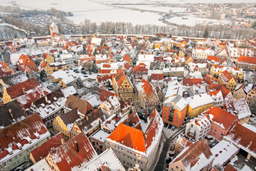 """Winter panorama of medieval town within fortified wall. Top view from """"Daniel"""" tower. Nordlingen, Bavaria, Germany."""