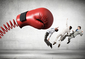 Businesspeople fighting with boxing glove