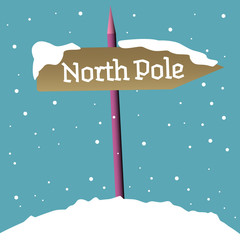 Colorful background with a signpost covered by snow and the text North Pole written on the signpost