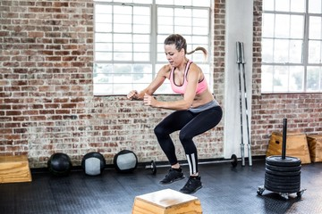 Fit woman doing jumping squats
