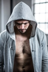 Fit man with hooded jumper